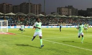 Alex Iwobi races away after guiding in Nigeria's winner.
