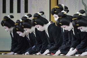 Women dressed as geishas rehearse for a show in Tokyo, Japan