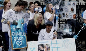 Supporters of Charlie Gard's family react after hearing his parents had dropped their legal bid.