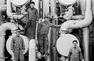 Workers at Beijing petrol refinery
