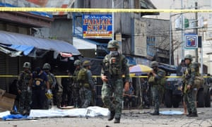 Philippine soldiers patrol the site of a deadly bomb blast in January in Sulu province, a stronghold of Islamist militants.