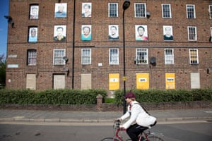 Samuel House, part of the Haggerston and Kingsland Estate in London. Photos of residents were placed over the windows of empty properties as part of the I Am Here art installation.