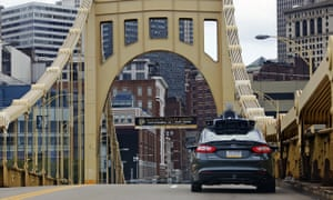 A self-driving Uber car drives across the ninth street bridge in downtown Pittsburgh, where the company is testing driverless rides.