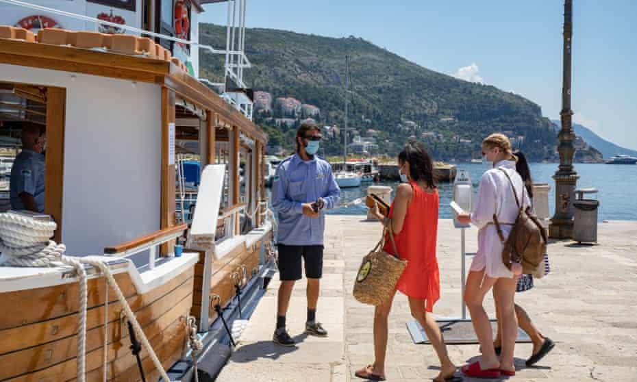 Visitors board a boat in Dubrovnik.