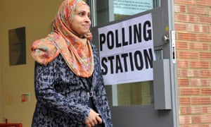 A woman leaves a polling station in Luton at the May 2015 general election.