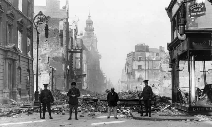 A British officer and two privates on guard near some of the worst destruction in Dublin in 1916.