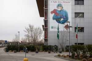 Bergamo, Italy A mural dedicated to all Italian medical workers depicting a nurse cradling Italy and reading 'To All Of You... Thank You!', on a wall of Papa Giovanni XXIII Hospital