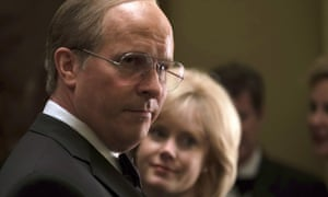 Christian Bale as Dick Cheney, with Amy Adams as Lynne Cheney behind