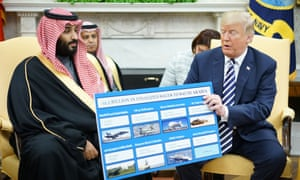 Donald Trump holds a defence sales chart with Saudi Arabia's Crown Prince Mohammed bin Salman
