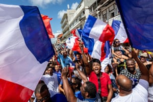 People celebrate in the streets of Cayenne, in French Guiana