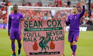 Before a match against Napoli at the Aviva Stadium in Dublin, Liverpool players Georginio Wijnaldum and Andrew Robertson carry a flag in support of Sean Cox