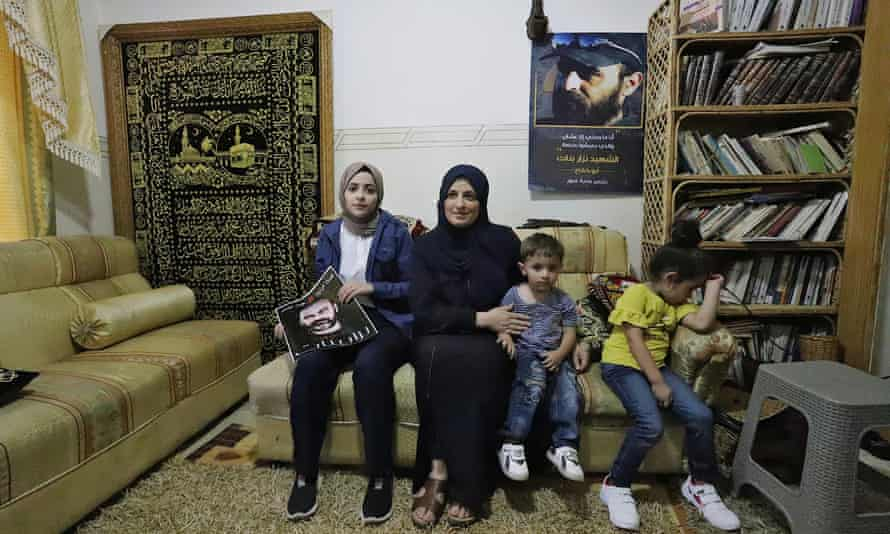 Jihan and three of her children at their home in Dura