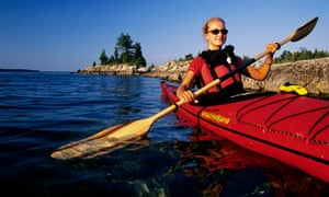 A kayaker paddles on Lake Huron in Fathom Five National Marine Park, Tobermory, Bruce Peninsula, Ontario, Canada.