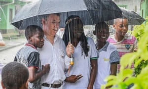 Colombian president Juan Manuel Santos poses with children before a religious ceremony with victims of violence in Bojayá, Colombia, 9 October 2016.
