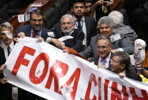 Members of Brazil's lower house celebrate the vote against Eduardo Cunha.