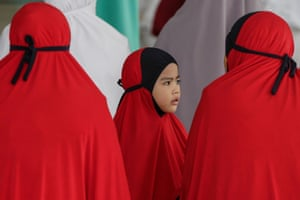 A young girl attends prayers at the national mosque