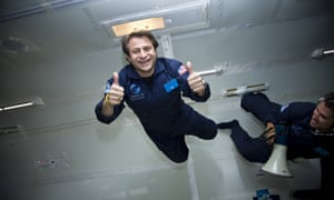 peter diamandis gives the thumbs up while floating in simulated zero gravity