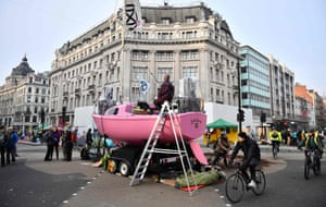 A pink boat occupies the centre of Oxford Circus
