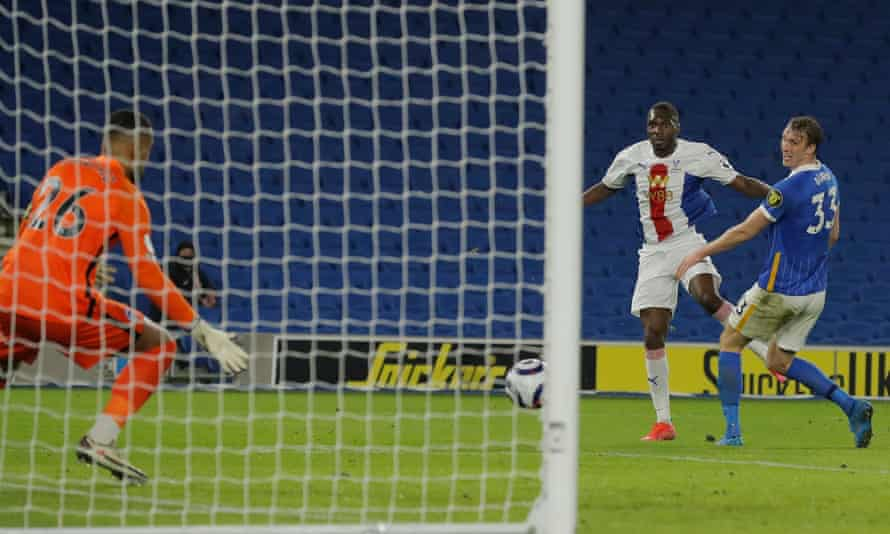 Christian Benteke beats Robert Sánchez in the Brighton goal with a stoppage-time volley to secure a 2-1 win for Crystal Palace at the Amex Stadium.
