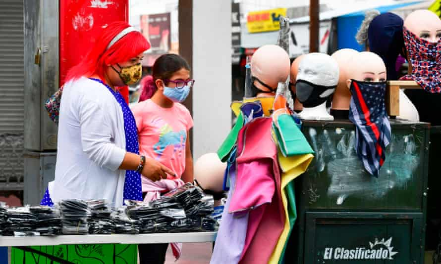 People shop for face coverings in Los Angeles, California.
