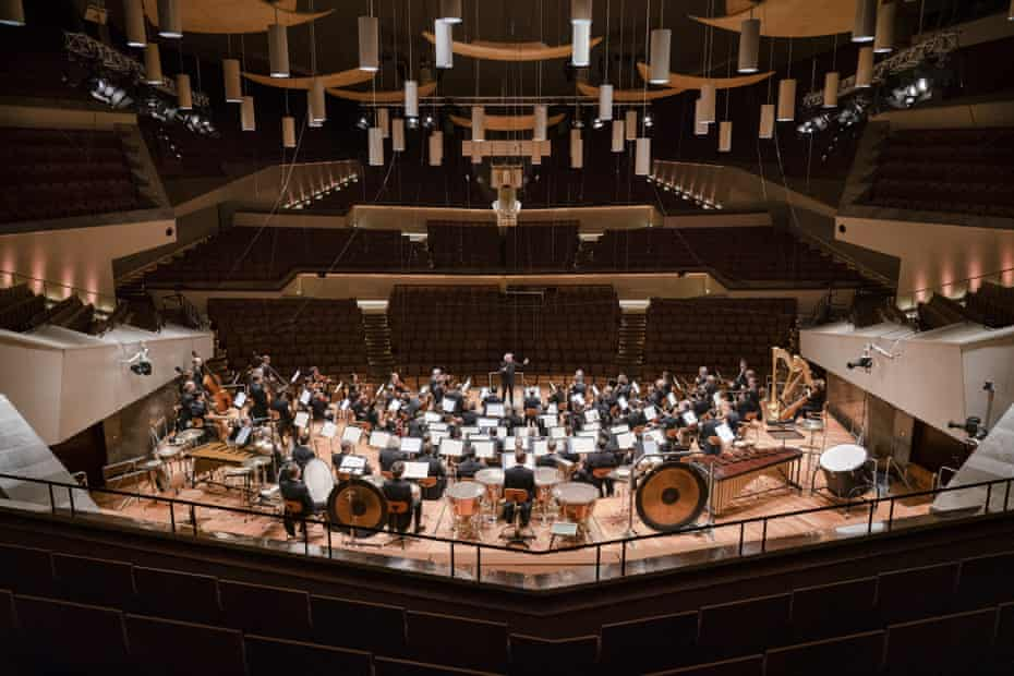 The Berlin Philharmonic, conducted by Simon Rattle, perform without audience at the Philharmonie, Berlin, 12 March.