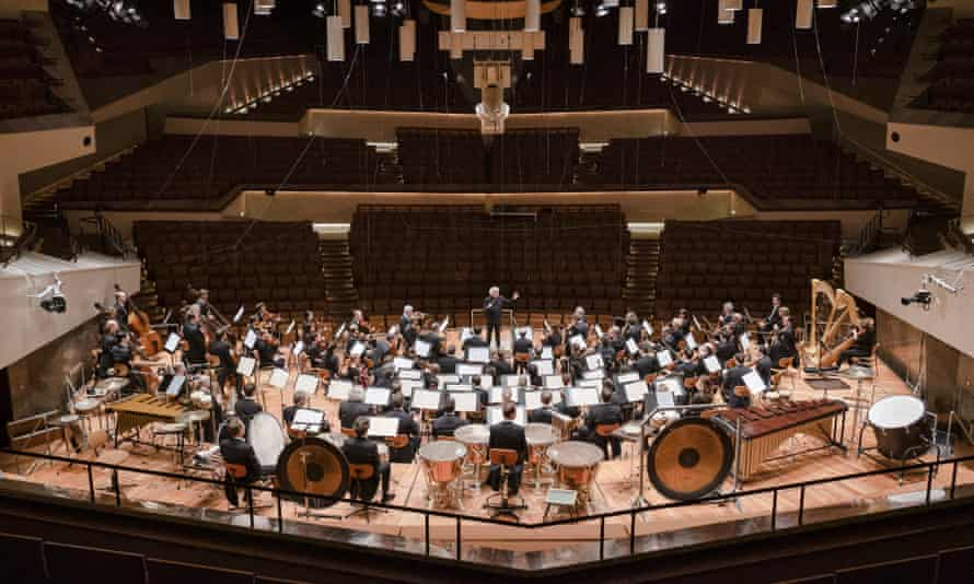 The Berlin Philharmonic with conductor Sir Simon Rattle perform without an audience at the Berlin Philharmonie, March, 2020.