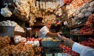 A shop selling garlic, onions and potatoes in Mumbai