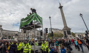 Activists erect a mobile scaffold in Trafalgar Square
