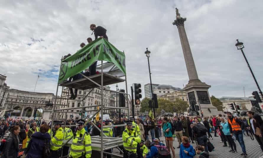 Activists erect a mobile scaffold in Trafalgar Square