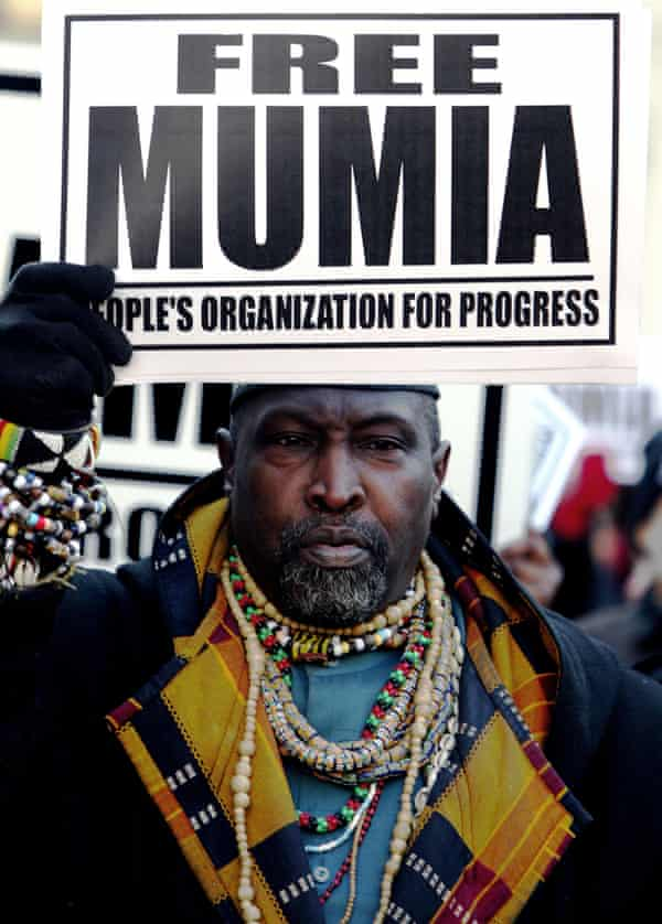 A supporter of inmate Mumia Abu-Jamal outside City Hall in Philadelphia, in 2006.