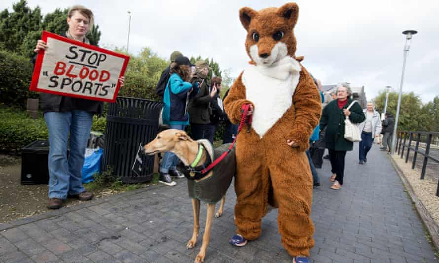 Anti-hunt campaigners outside the National Trust AGM at the Steam Museum in Swindon.