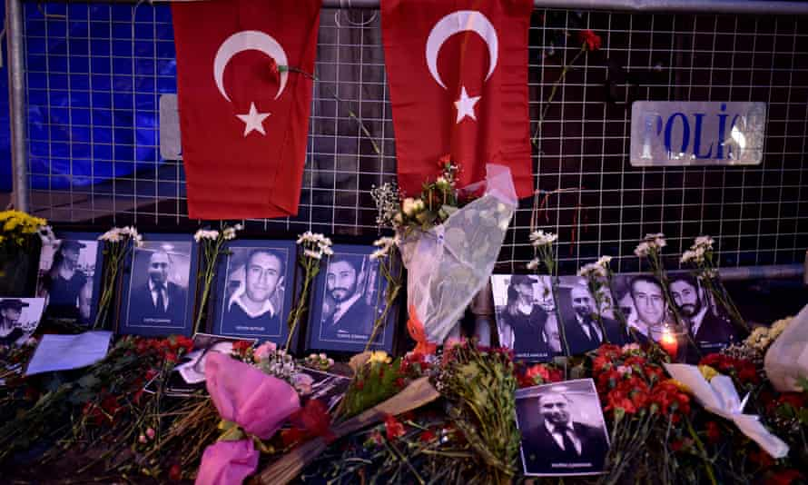 Flowers and pictures of the victims