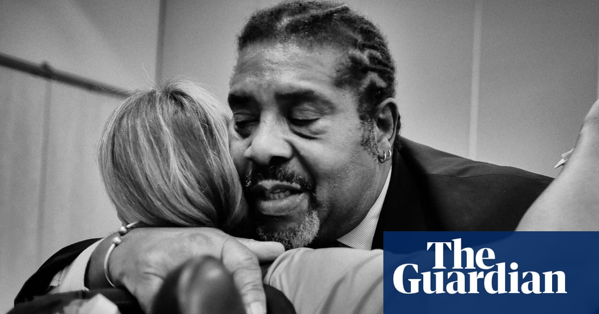 image link to source article in the Guardian - two people hugging