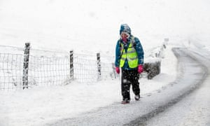 A walker on the road between Ingleton and Hawes in the Yorkshire Dales National Park.