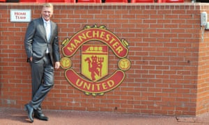 David Moyes poses on his first day as Manchester United manager in 2013.