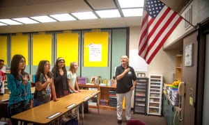 A teacher leads her middle school students in the Pledge of Allegiance on the first day of middle school in Aliso Video, California.