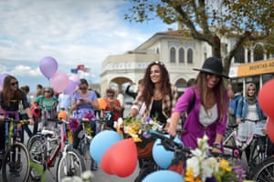 Turkish women ride their bikes during a bicycle parade to celebrate World Car Free Day in Istanbul