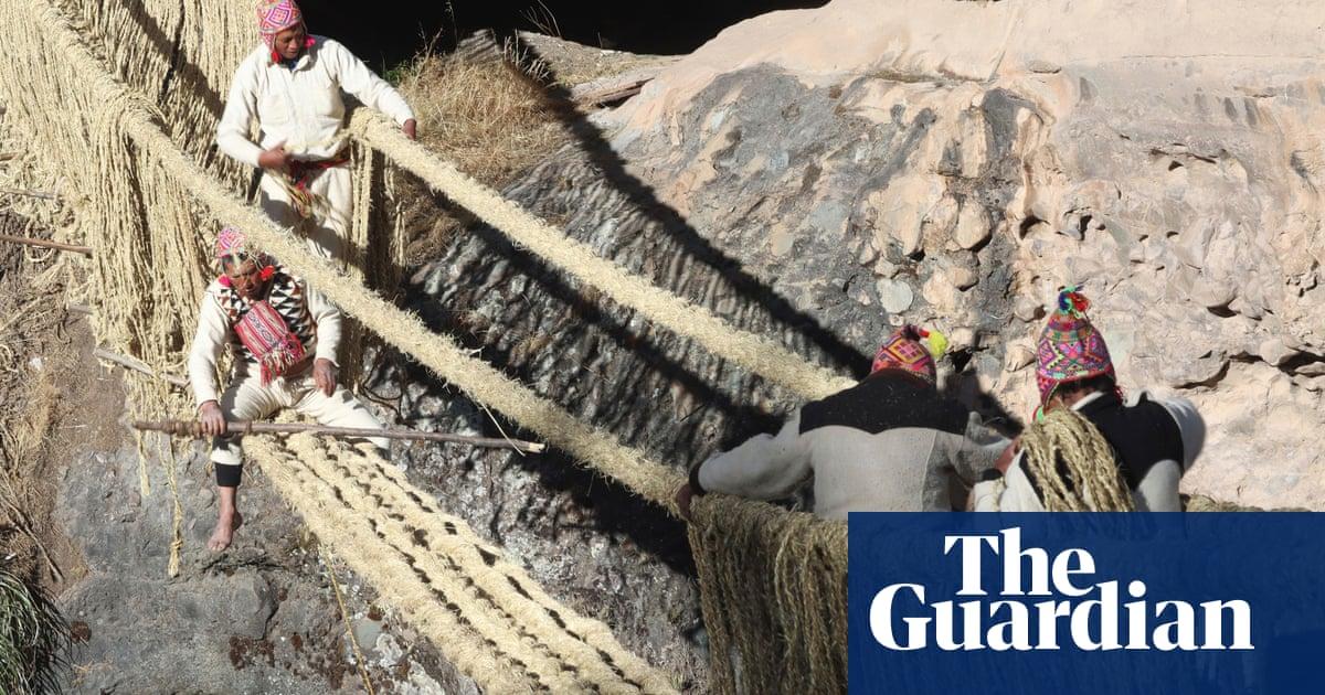Peruvians re-weave Incan hanging bridge spanning river – video