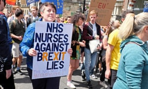 A nurse's poster  at a pro-EU rally raises fears for  the future of the NHS after Brexit.