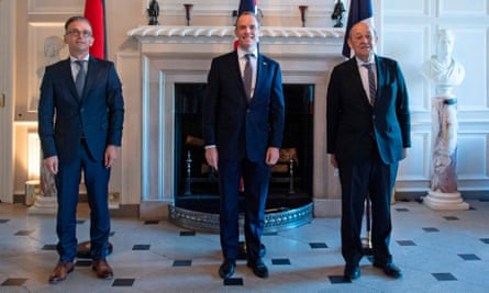 German foreign minister Heiko Maas, Britain's foreign secretary Dominic Raab and French foreign minister Jean-Yves le Drian pose for a photograph at Chevening House, Sevenoaks.