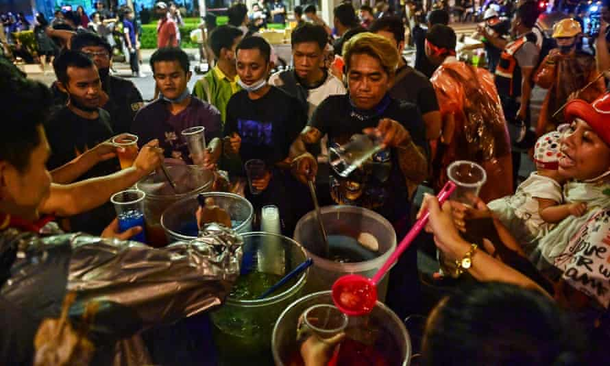 Pro-democracy protesters at a street food stall in Bangkok