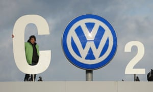 Greenpeace activists demonstrate at the entrance to the Volkswagen plant in Wolfsburg, Germany. The allegations of the Justice Department's lawsuit could cost Volkswagen billions of dollars, according to officials.