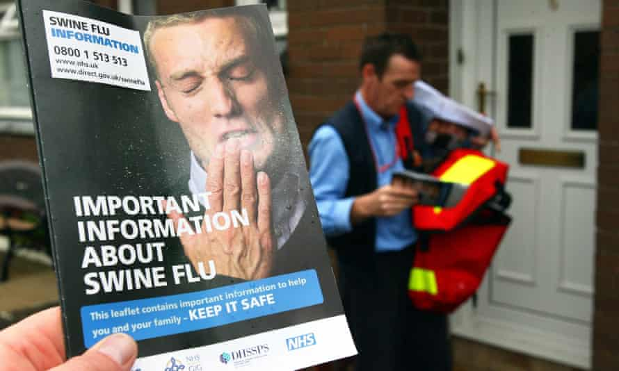 A postman delivers swine flu leaflets in Glasgow