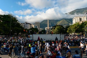 Opposition supporters protest against the government of President Nicolas Maduro