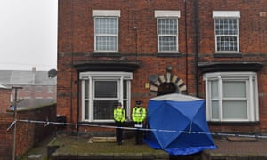 Police outside a house in Stafford being searched following the attacks in London.