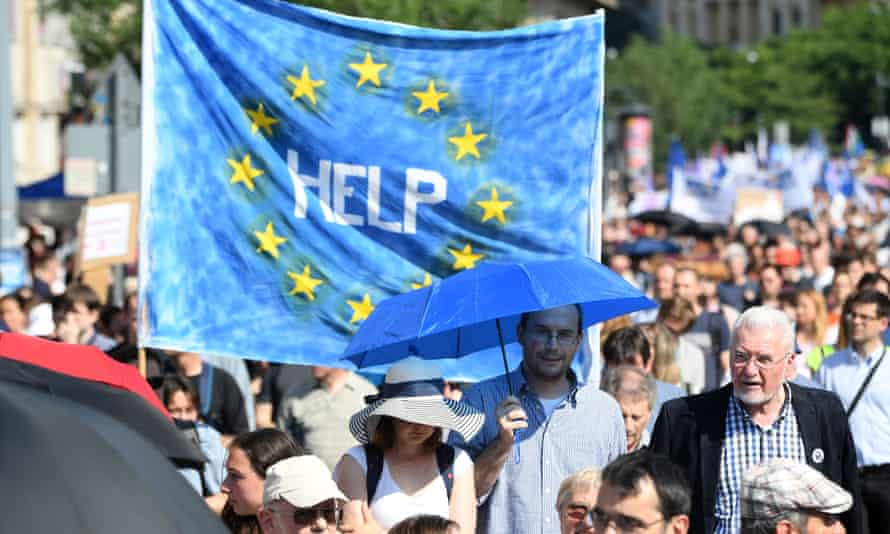 A message to the EU is held aloft during a protest in Budapest on 2 June over the Hungarian government's controversial education and research policies.