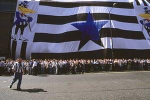 Newcastle fans wait outside St. James' Park to greet Asprilla.