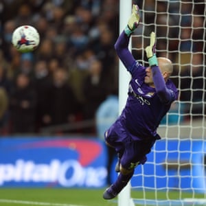 Willy Caballero saves from Liverpool 's Lucas Leiva.