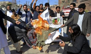 Pakistani protesters burn an effigy of Indian Prime Minister Narendra Modi during a rally in Peshawar, Pakistan, on Wednesday