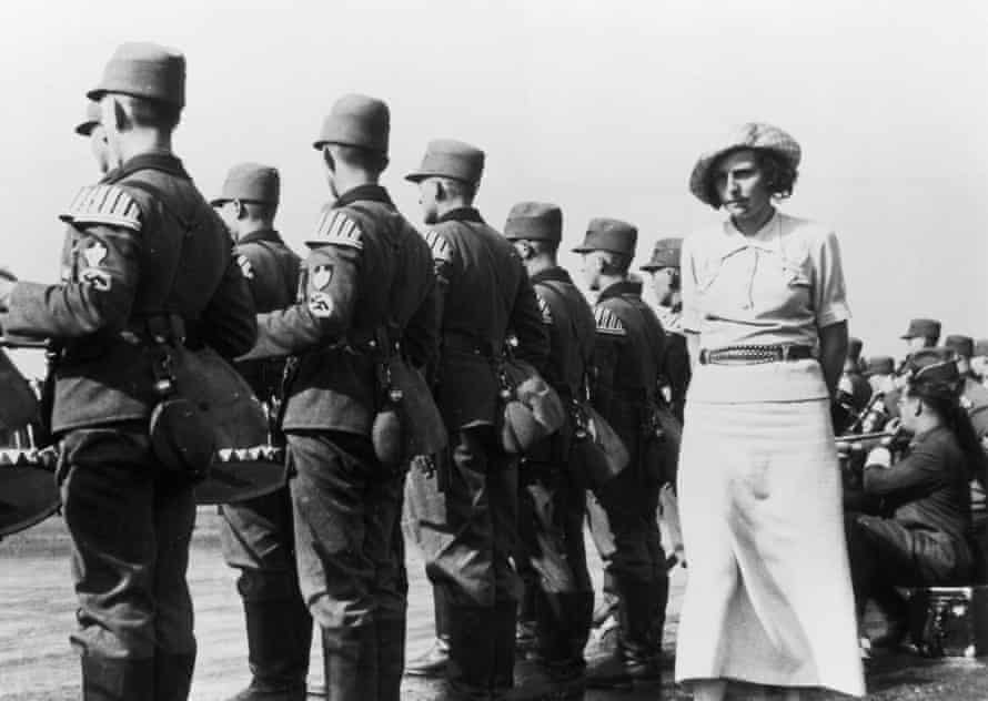Riefenstahl walks behind a line-up of Nazi soldiers in Nuremberg, 1935.